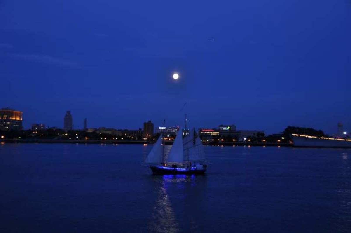 Sailing under a full moon past Penn's Landing in Philadelphia.