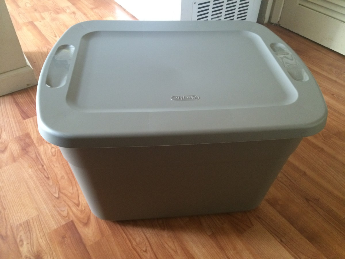 A 16-gallon plastic storage box works great