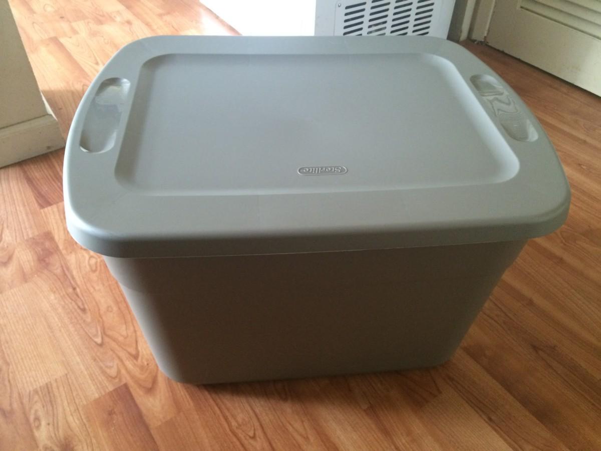 A 16-gallon plastic storage box works great