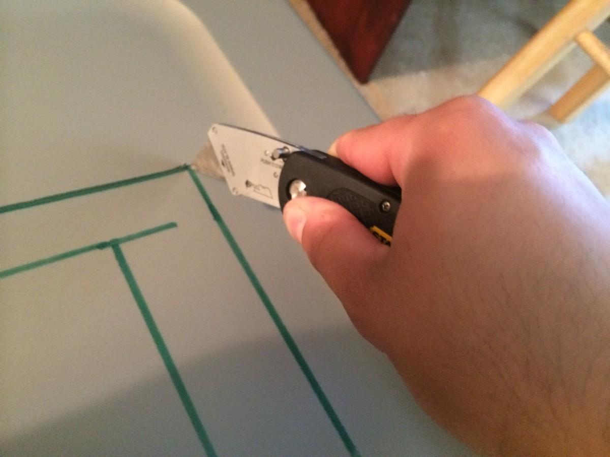 A standard utility knife can cut through flimsy plastic.