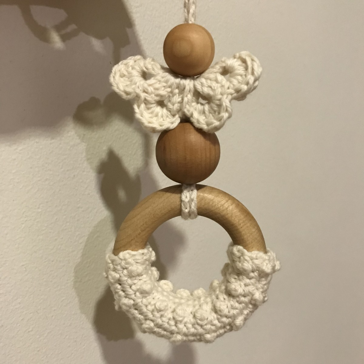 Berry-Stitched Teething Ring Turned Into a Teething Necklace With Crocheted Butterfly and Wooden Beads
