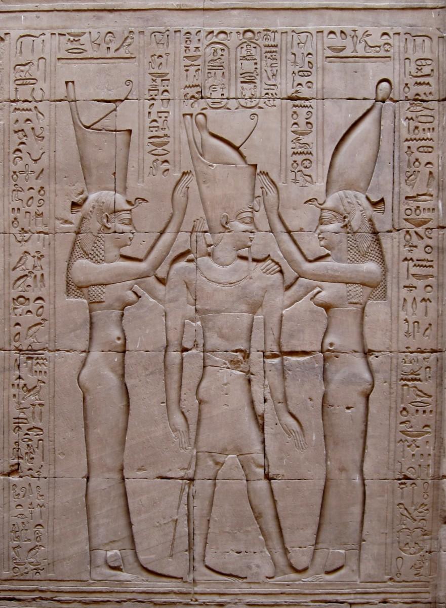 Pharoah Ptolemy VIII between the goddesses Wadjet and Nekhbet. (Temple of Edfu, Egypt)