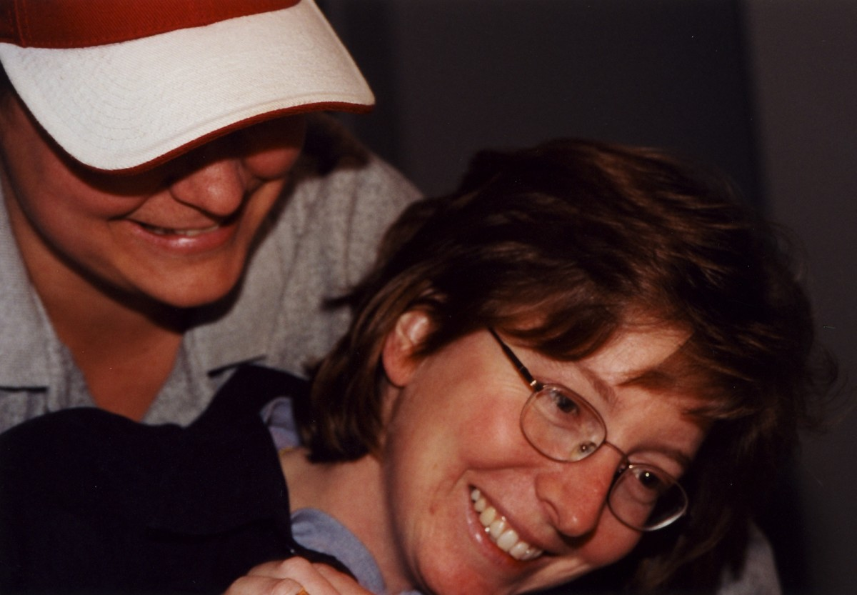 Deb with her best friend Chrissy rough-housing at a get together.