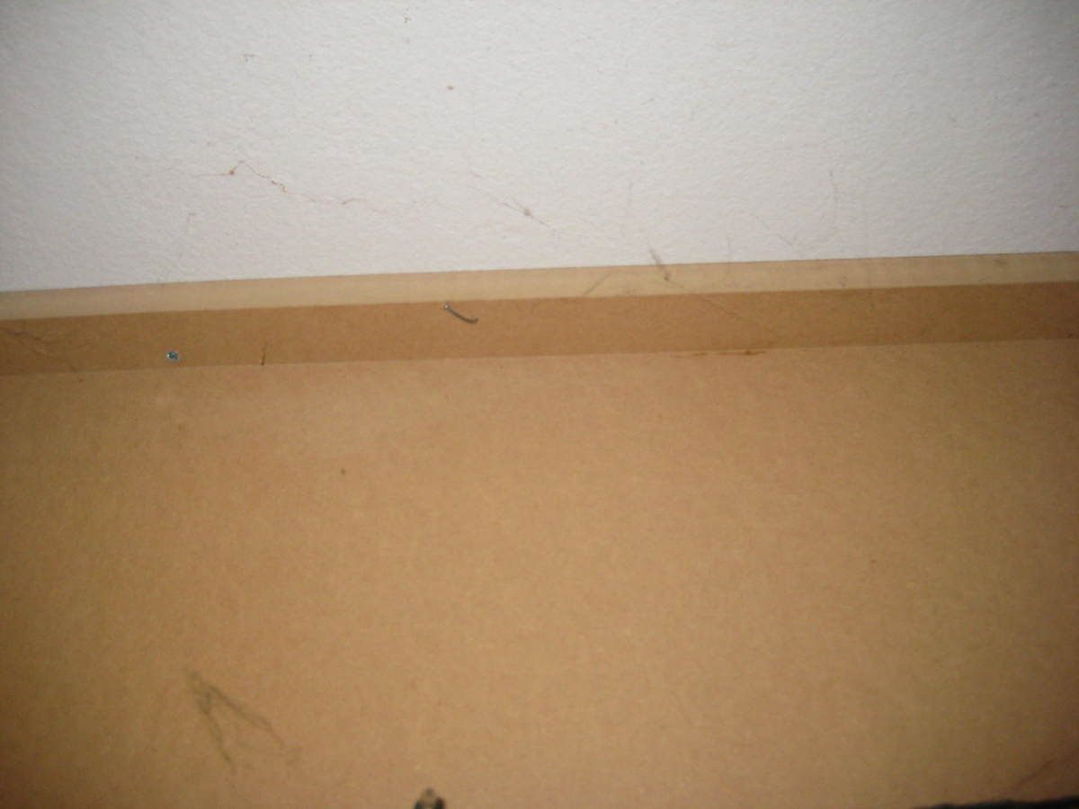 Batten securing board to ceiling