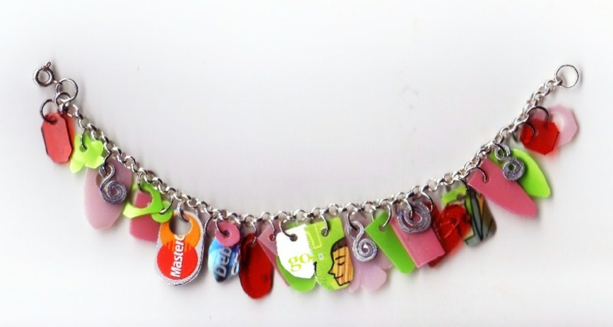 This bracelet was created with an upcycled debit card, shampoo bottle, Starbuck's card and more.