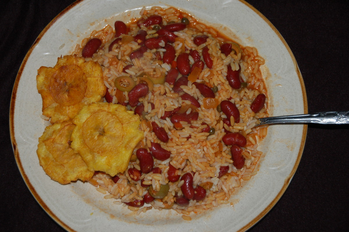 This is the only way a self respecting Puerto Rican eats rice and beans! All mixed together!