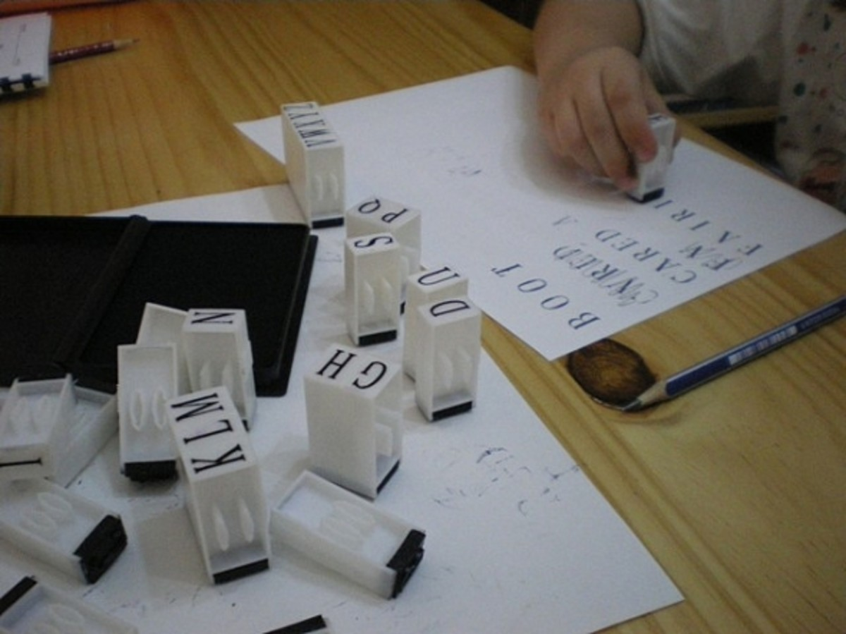 Spelling with alphabet ink stamps