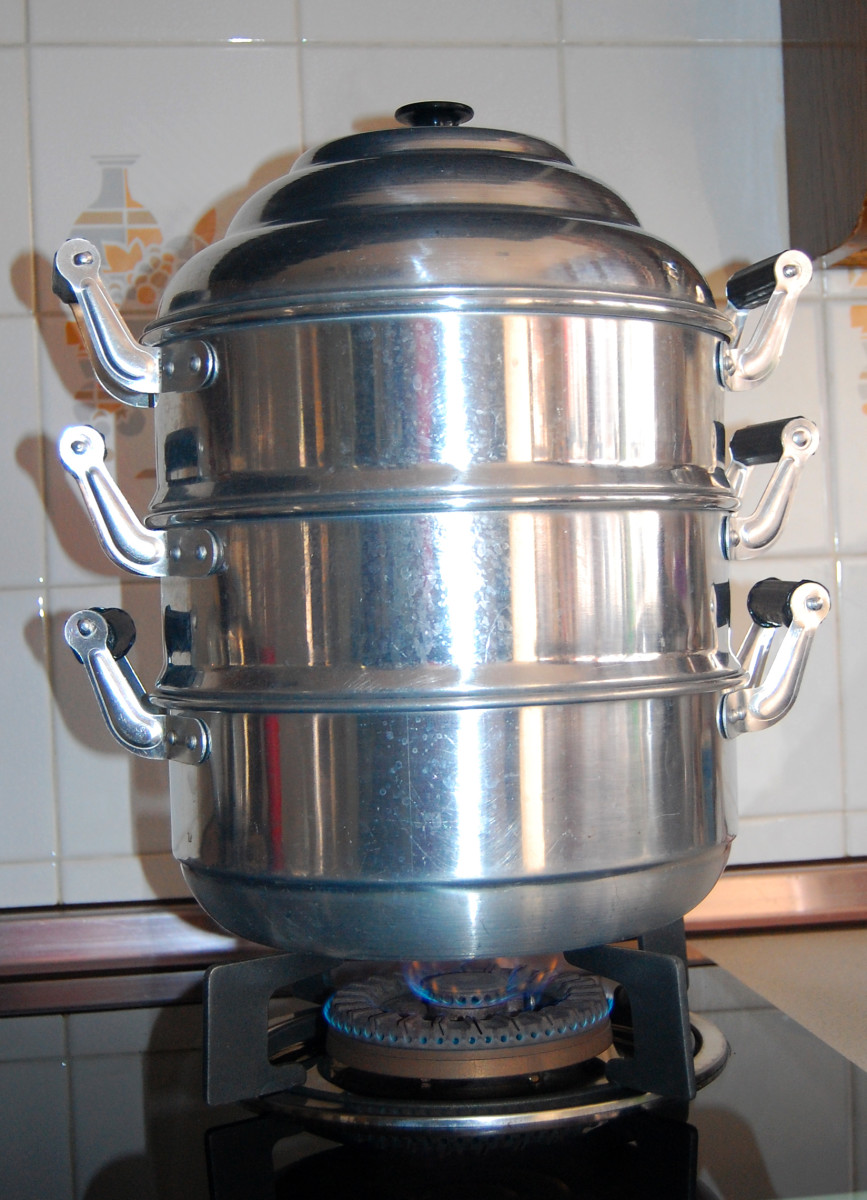 This is an inexpensive 2-tier steamer made of aluminum. The stainless steel steamers are expensive. The bottom unit holds the boiling water which produces the steam.