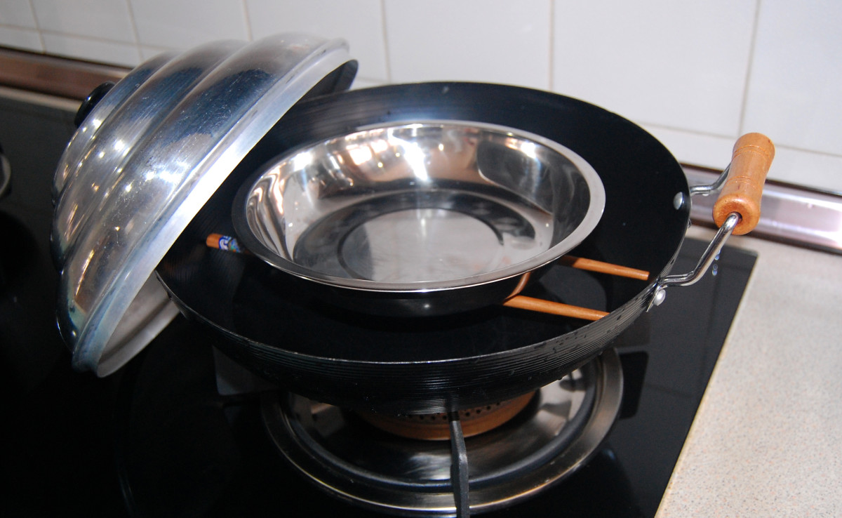 A Chinese wok , a pair of wooden or bamboo chopsticks and a dome-shaped cover - an all-time favorite for those in need of a steamer in a hurry.