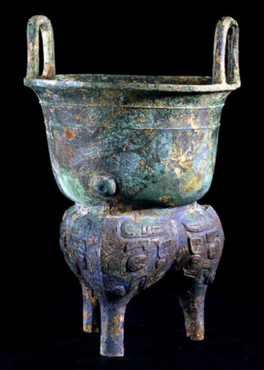 Shang Dynasty Bronze Yan Steamer with Inscription. Bronze working is believed to have developed in China without  the influence of outside cultures around 2000 B.C. This cooking vesseI was produced during the Shang, or Yin (18th–12th  century BC),