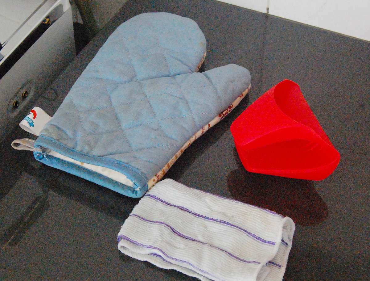 An oven glove, a rubberized finger glove or a moist kitchen keep your fingers from getting steam burn