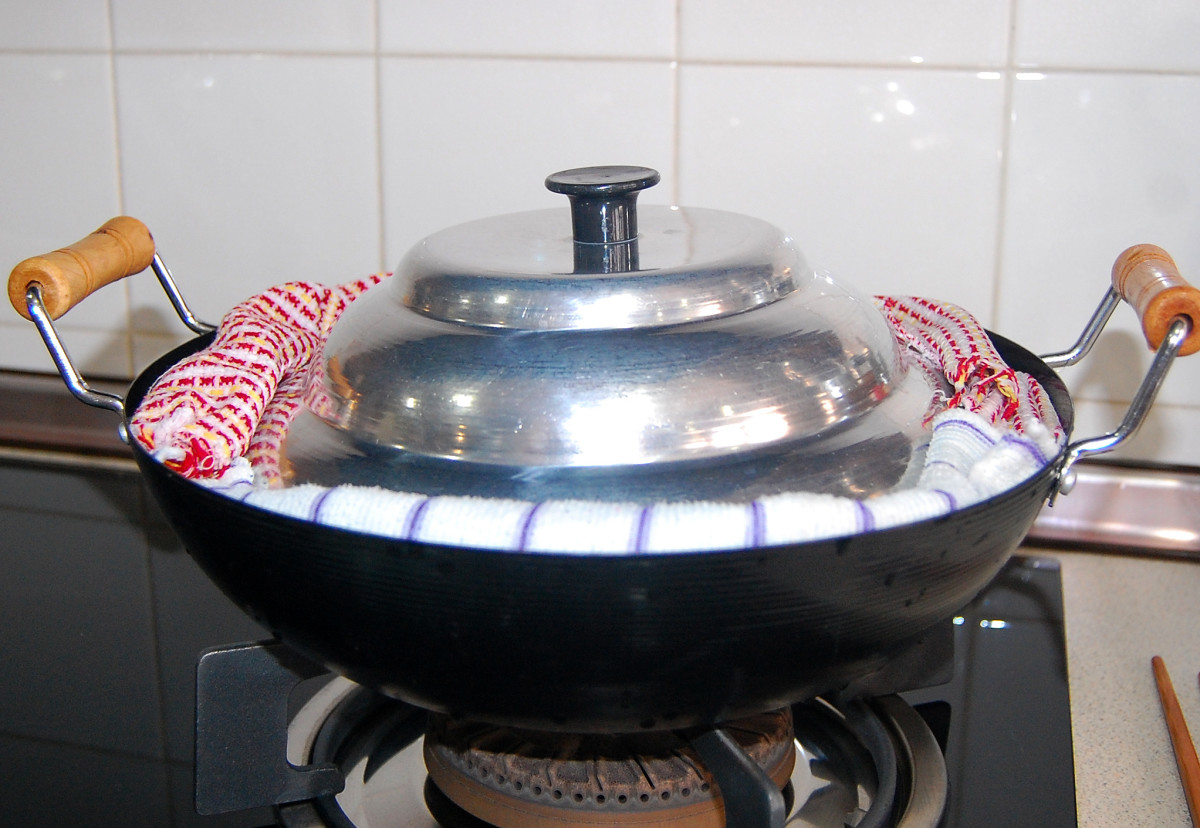Use moistened clean kitchen cloth and place them firmly around the steamer, covering the gap between the steamer cover or lid and the wok to keep steam from escaping.