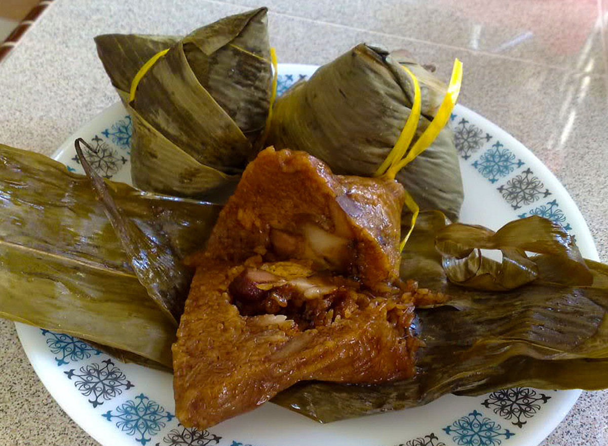 Glutinous rice with meat, mushroom and beans wrapped in bamboo leaves and steam cooked to perfection.