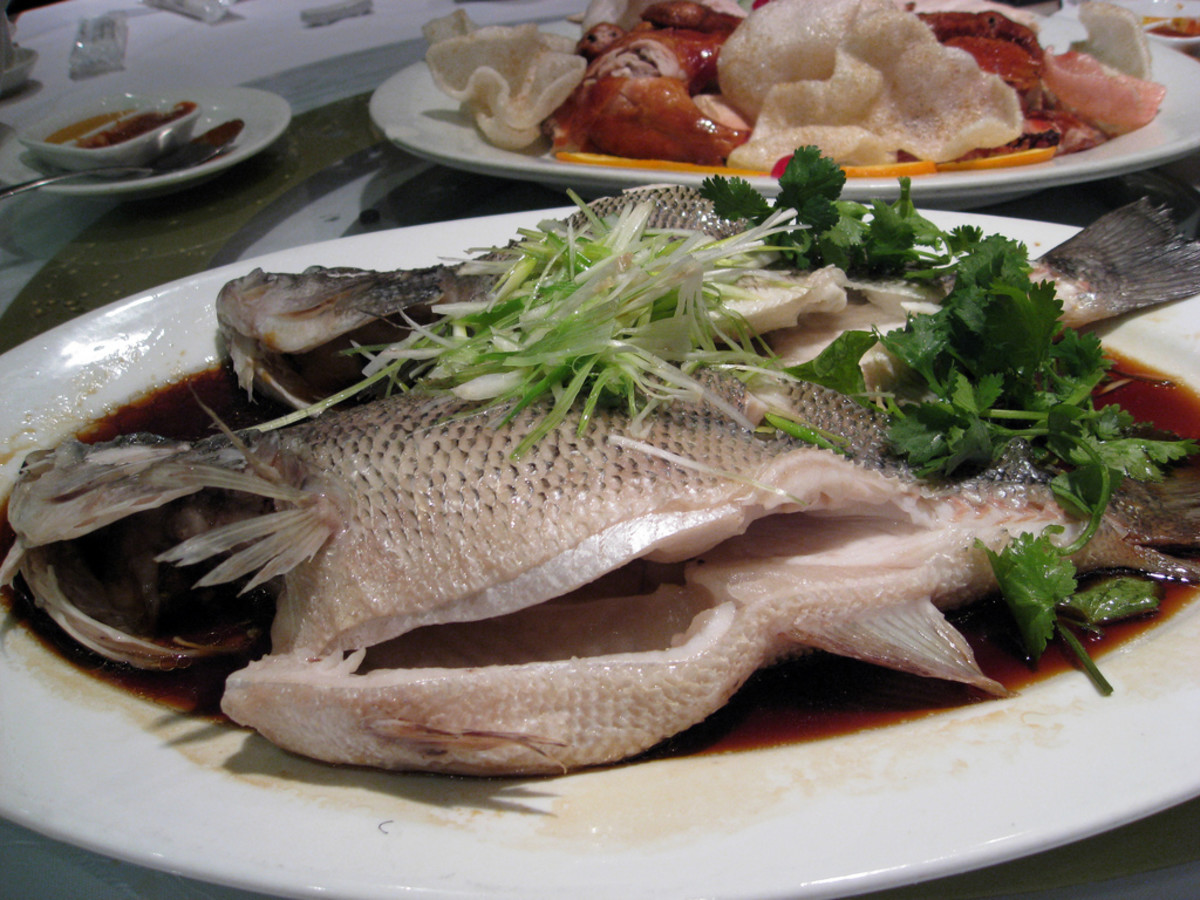 The Chinese love to eat steamed fish with just some light soy sauce and garnished with chopped spring onions and celery.