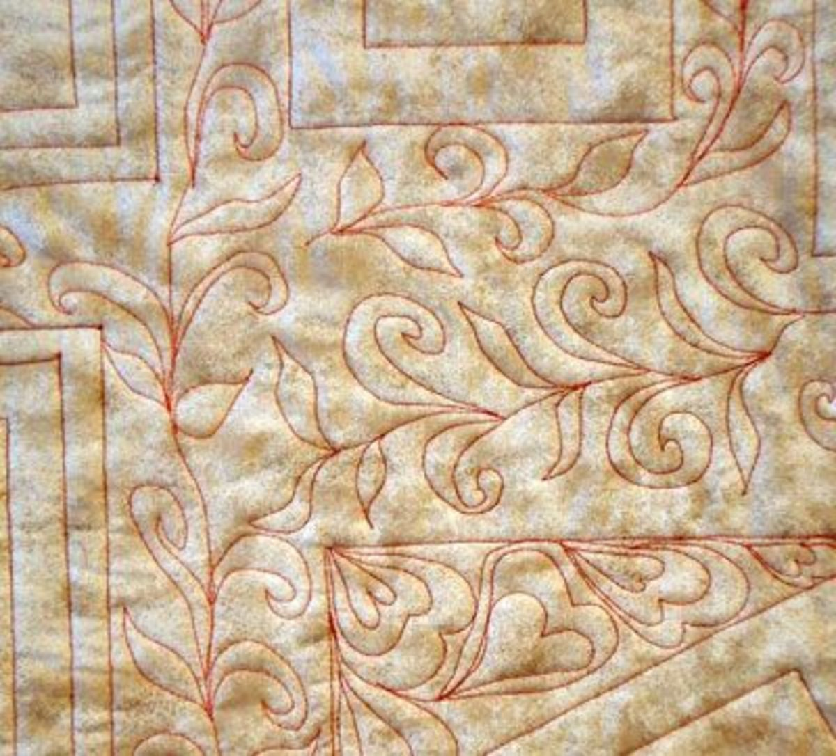 Detail of free machine stitching on the back of a quilt