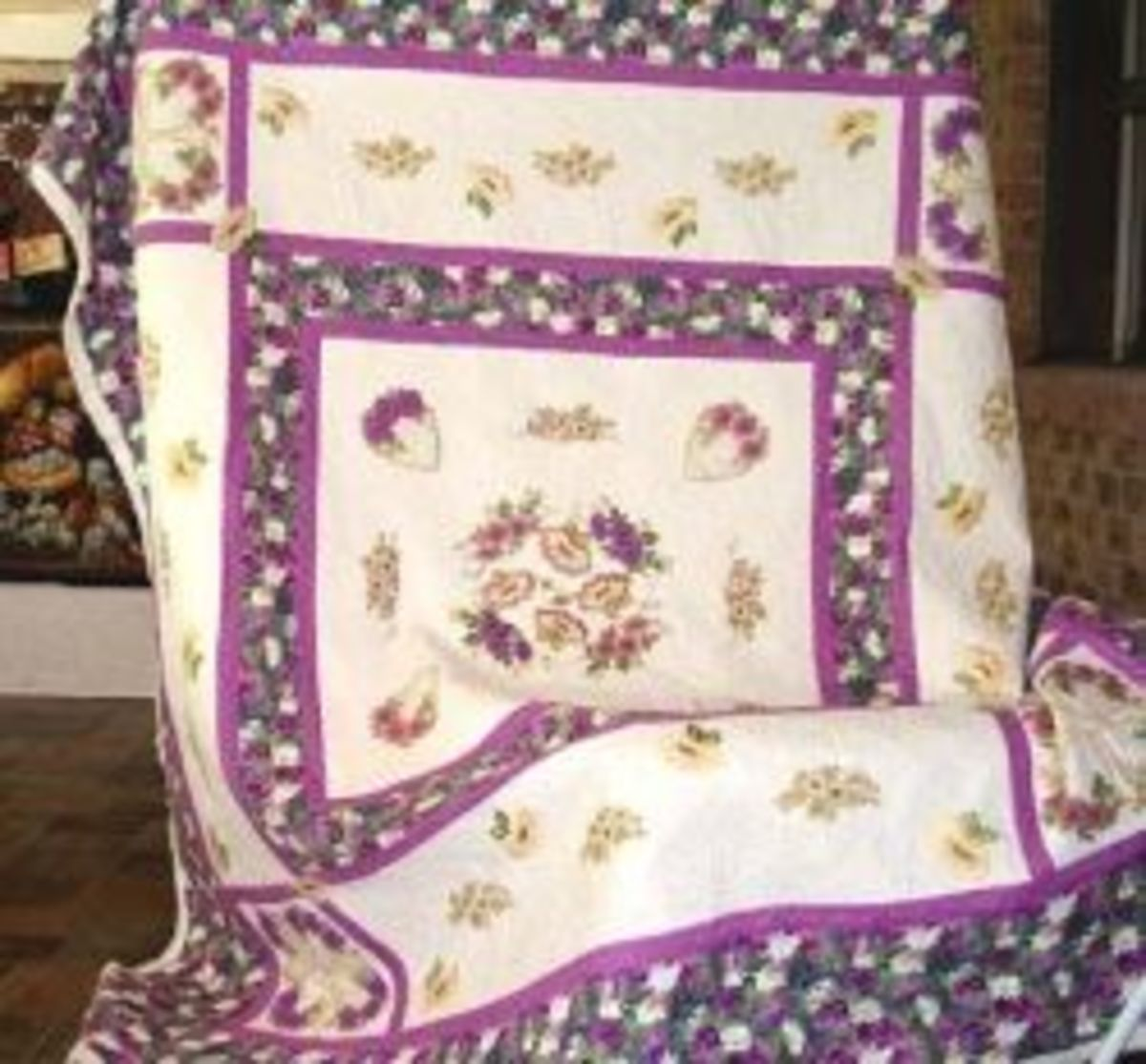 Heavily stippled and feather quilted quilt