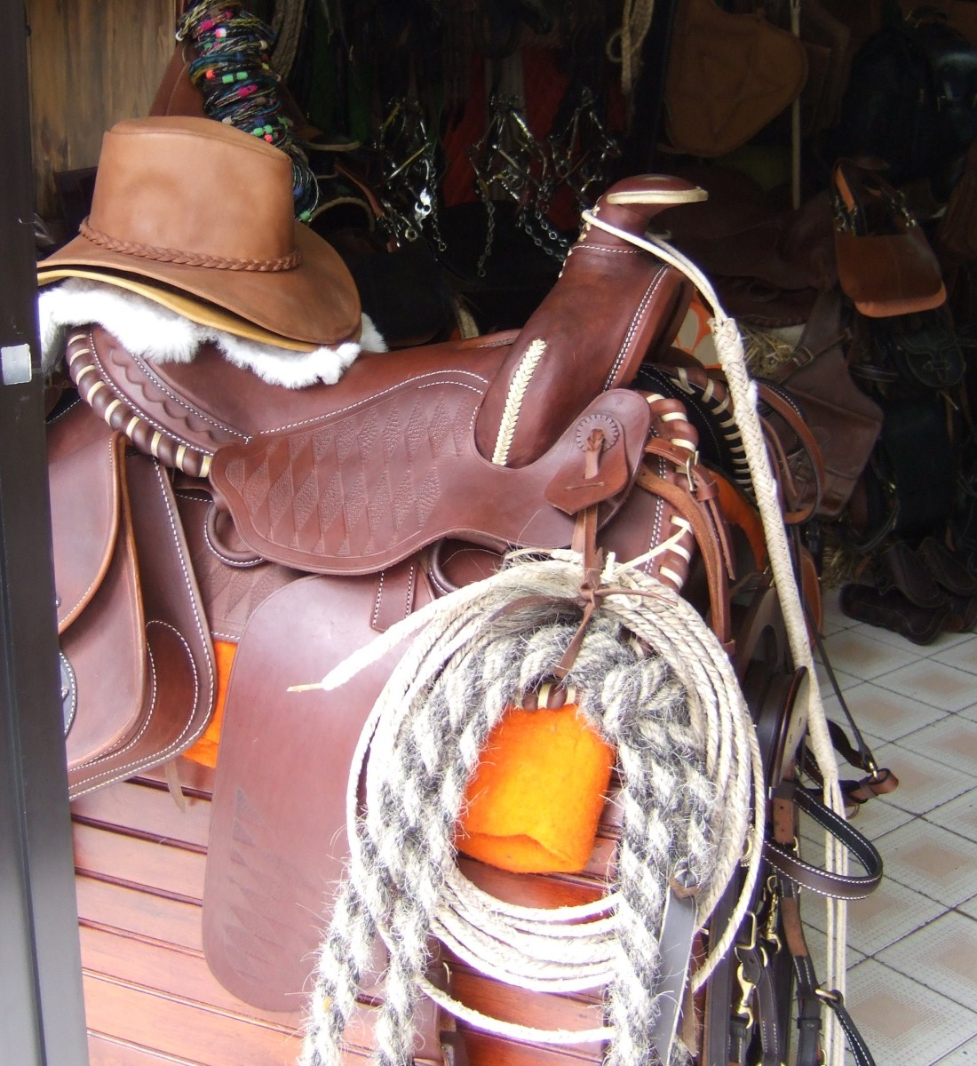 Beautiful handmade saddles in a Cotacachi shop, along with hats, horsehair lassos, and other equestrian items.