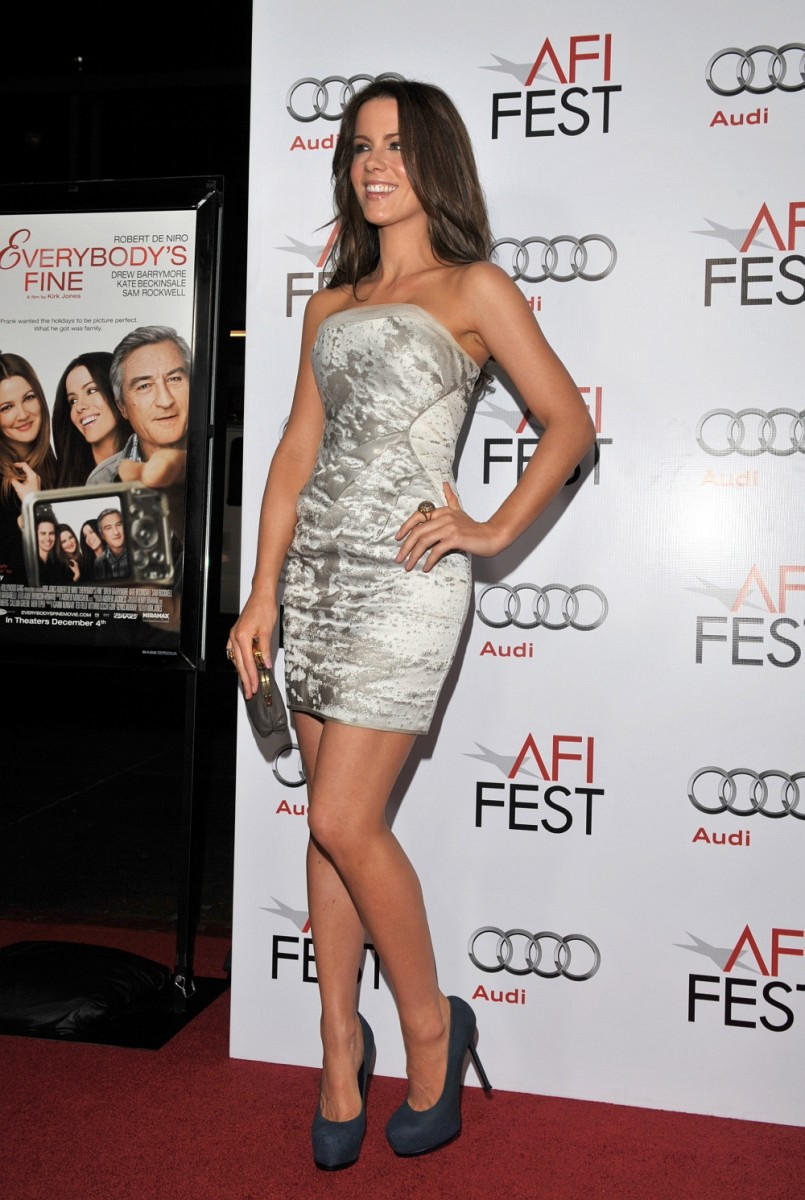 Kate Beckinsale at the Everybody's Fine LA premiere in a short and strapless dress and towering high heels