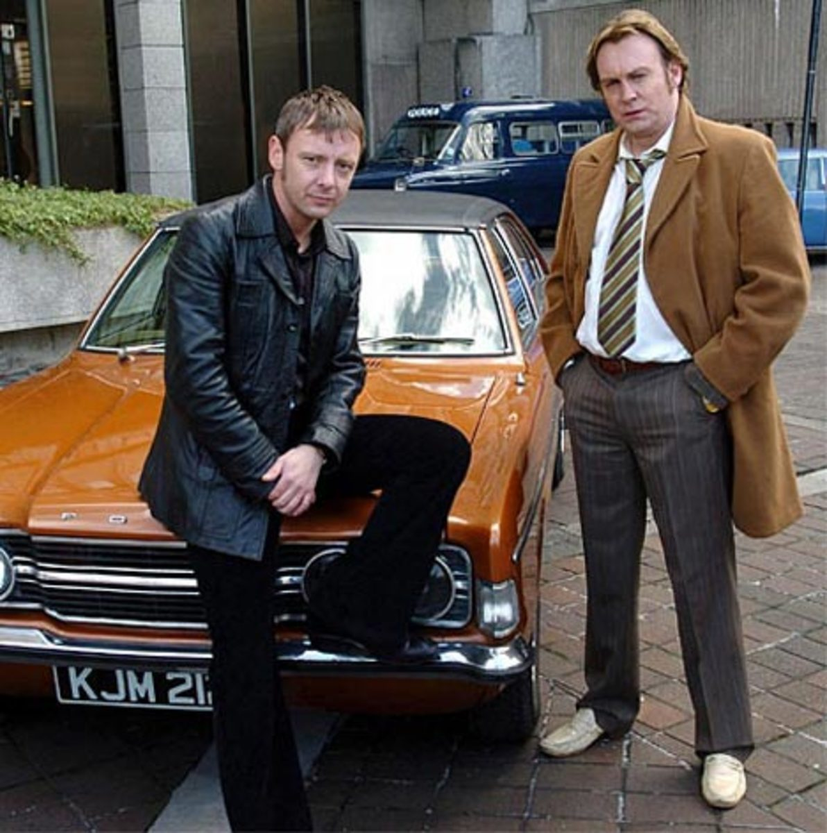 John Simm as Sam Tyler and Philip Glenister as Gene Hunt.