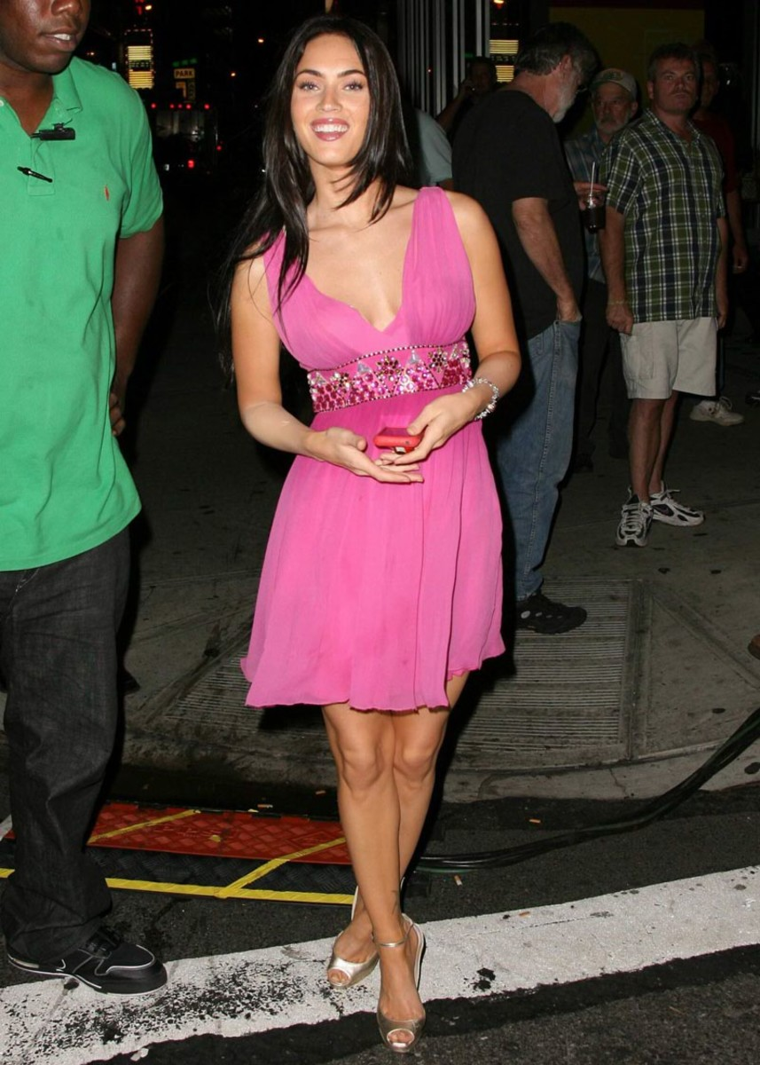 Megan Fox in a short pink dress and high heels