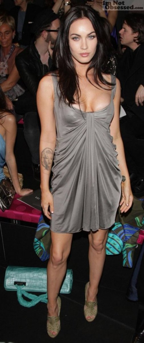 Megan Fox in a short gray dress and high heels