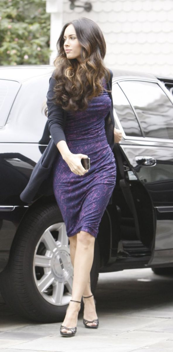 Megan Fox in a tight purple dress and strappy high heels