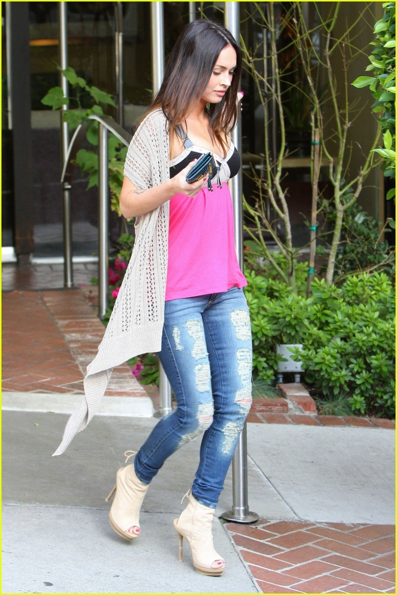 Megan Fox in torn and tight jeans and high heels