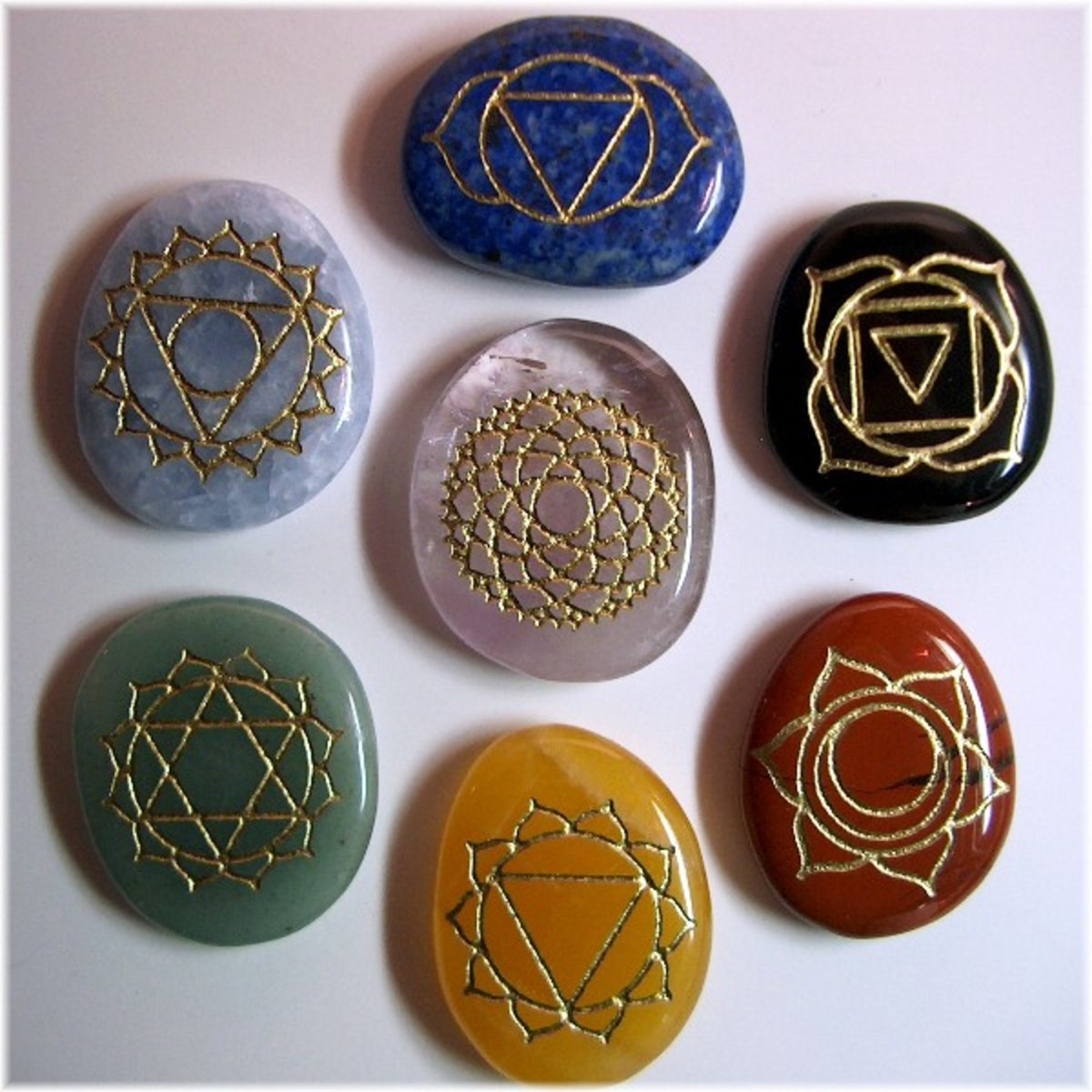 Crystals with symbols of 7 major chakras, to be placed on chakras