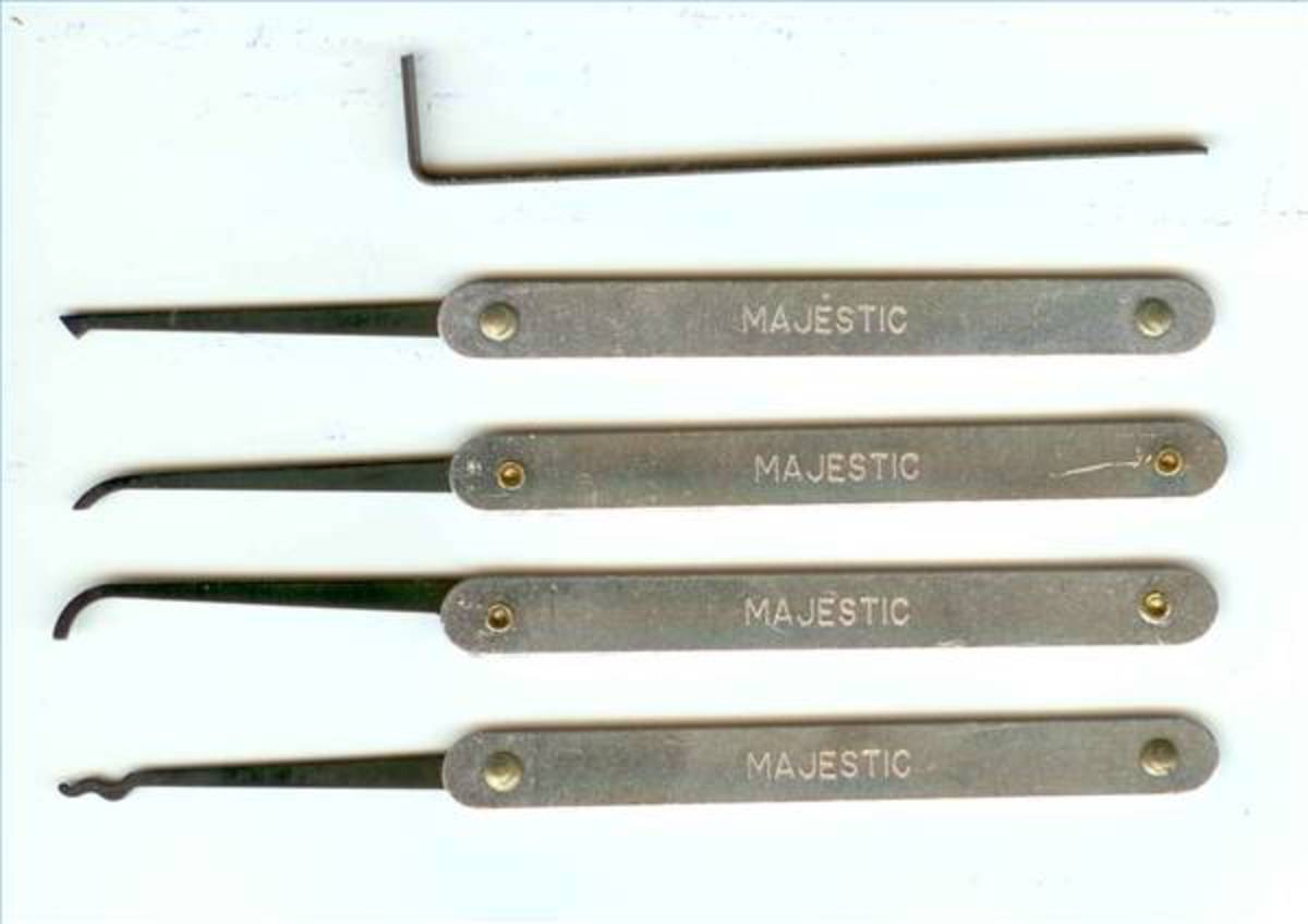 The top tool is the tension wrench. This is what your paper clip will need to resemble. The others are various lock picks.