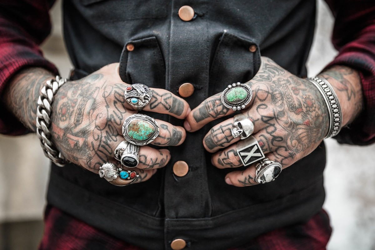 Hand tattoos fade fast. The easiest solution is to simply not let it bother you.