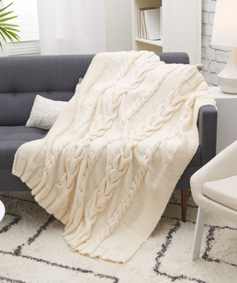 Just imagine this Luxurious Cabled Throw resting on your living room sofa.  You can get this free pattern on coatsandclark