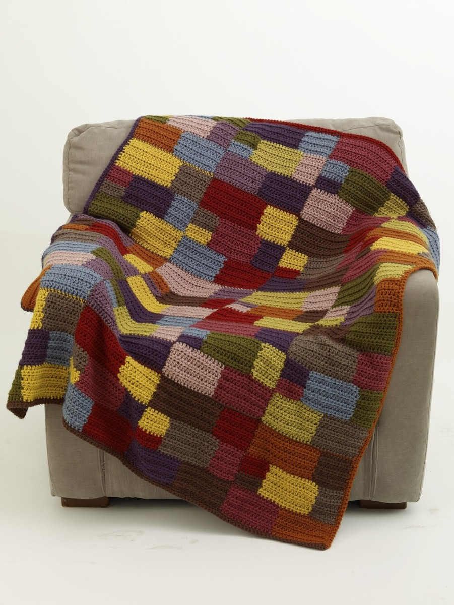 This colorful afghan is called the patchwork afghan.  It is made up of many squares of different colors.  This pattern is at lionbrand