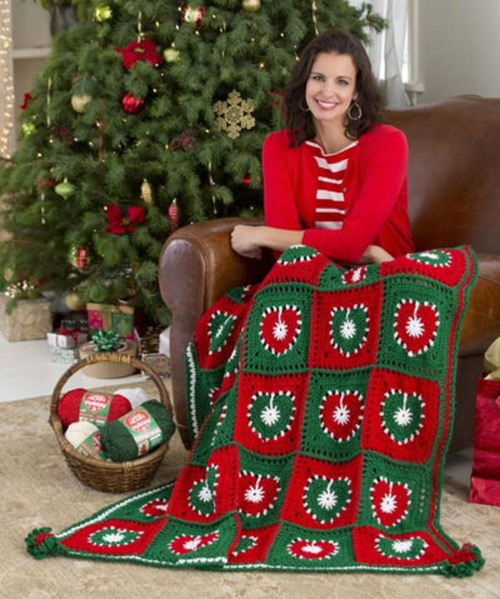 In the spirit of the Christmas season I bring you the Holiday Hearts Throw/  You will find the free pattern on favecrafts