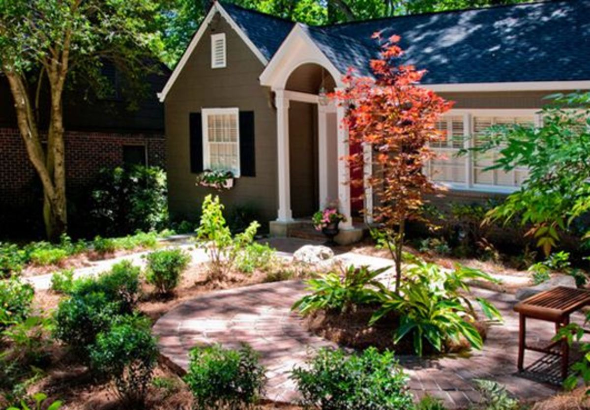 Great curb appeal. Focal point here is the lovely tree with its surrounding seating area.
