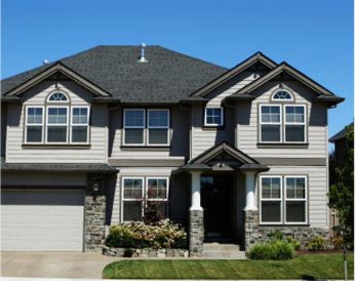 This home s exterior is asymmetrical and the trim is close in color to