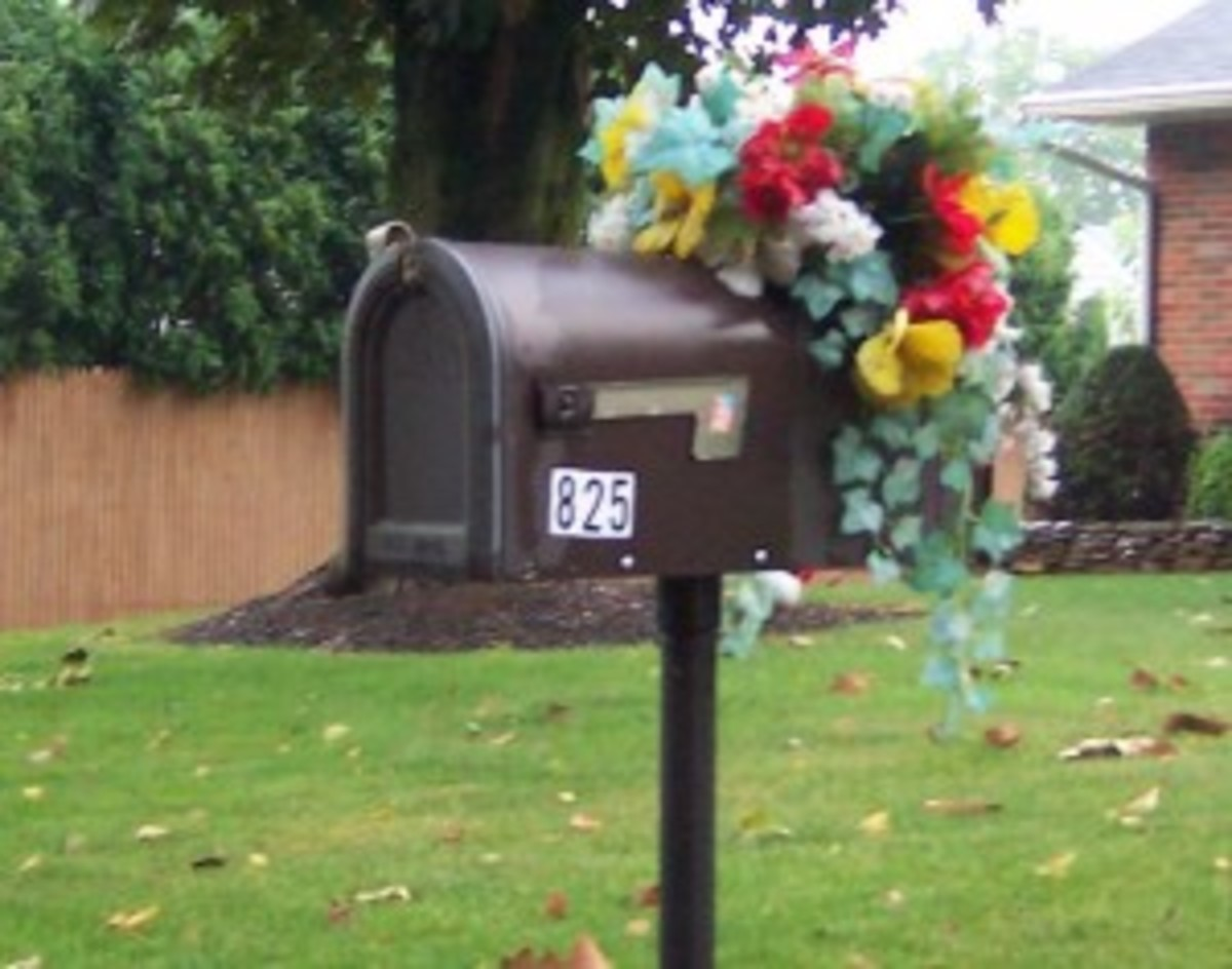 A definite mailbox DON'T - no ugly fake flower bouquets and see how cheap those stick-on numbers look?