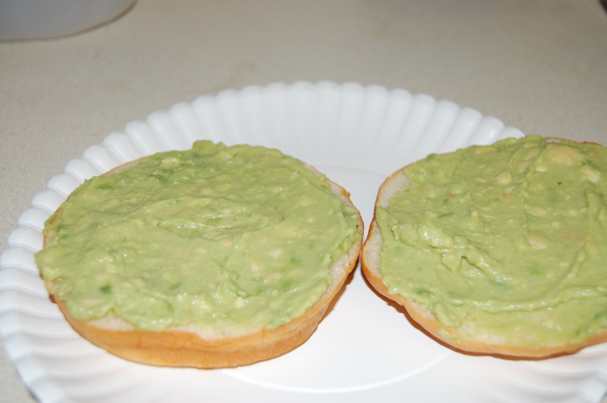 Mash avocado and spread on buns.
