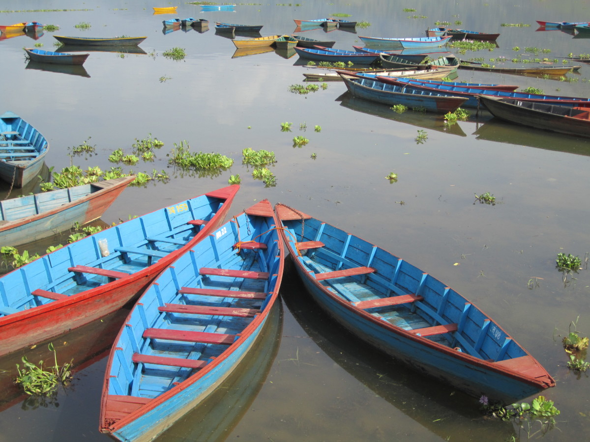 Colorful boats at Phewa Lake in Pokhara, Nepal