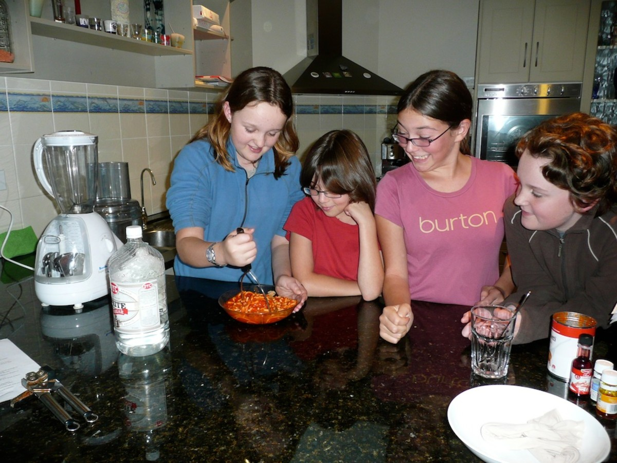 Mashing the food to simulate teeth.