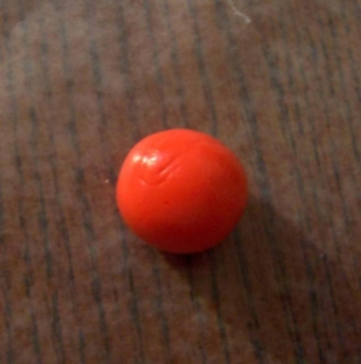 Sugar pumpkins, step 1. A ball of orange fondant.