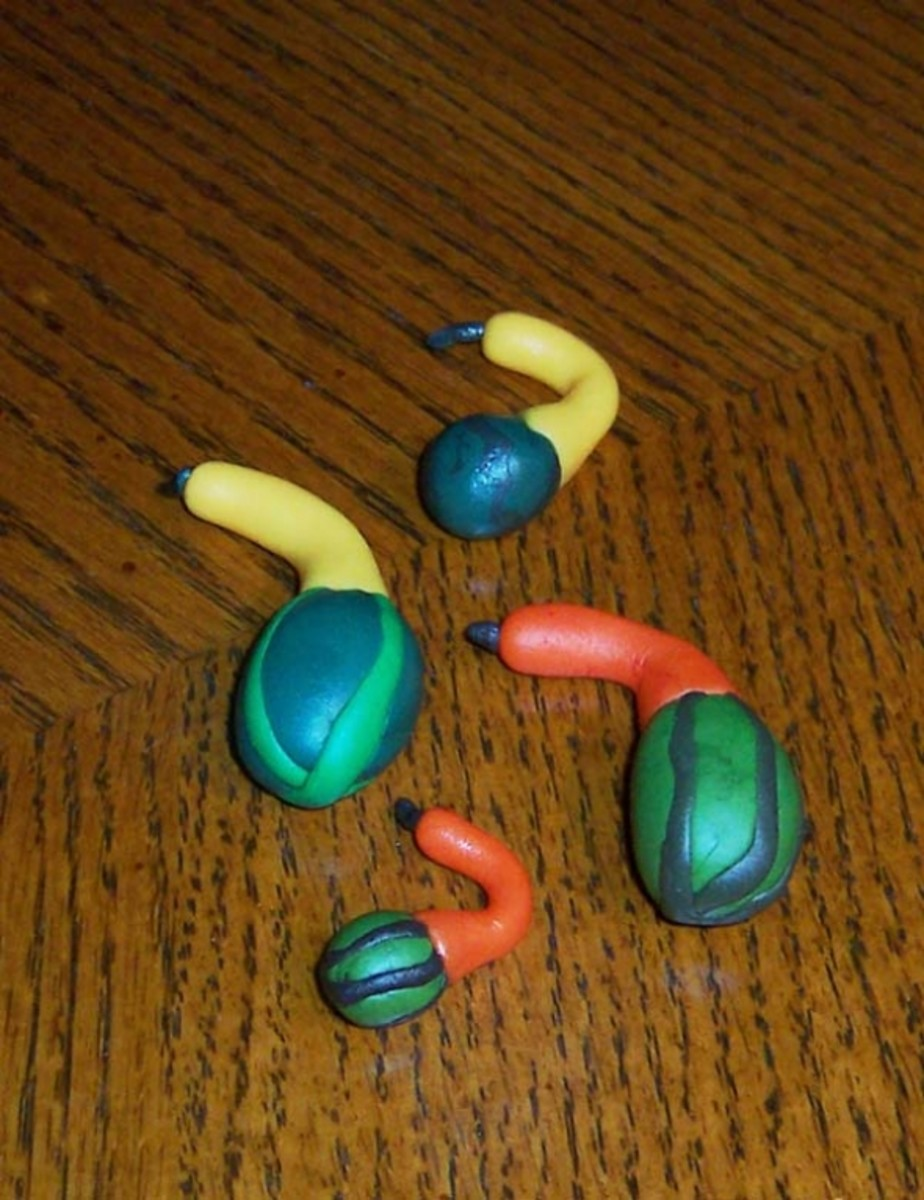 Four tiny fondant gooseneck gourds