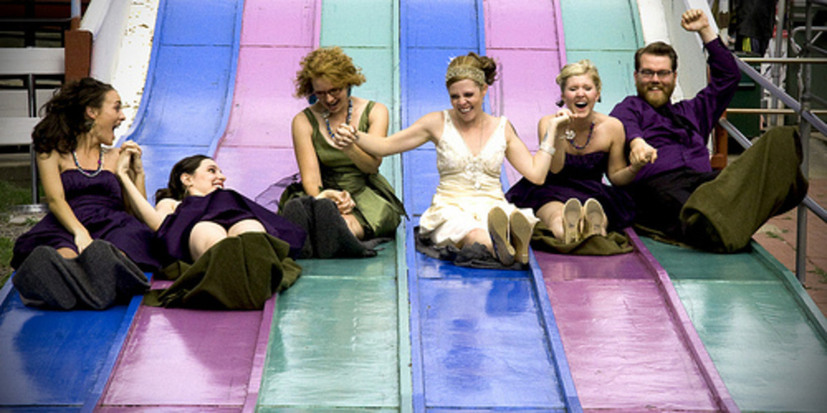 members of a bridal party go down the superslide