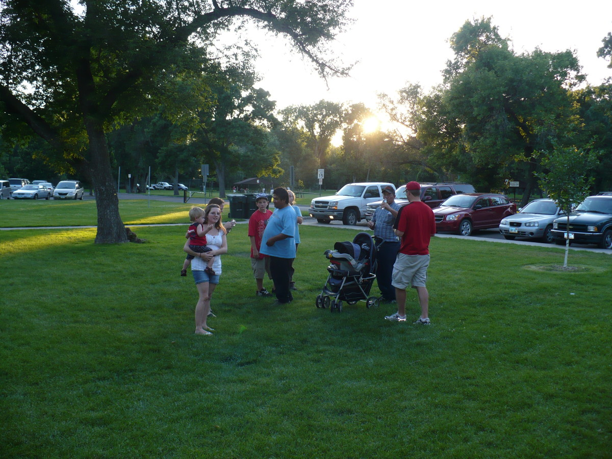 A family gathers at Sertoma Park