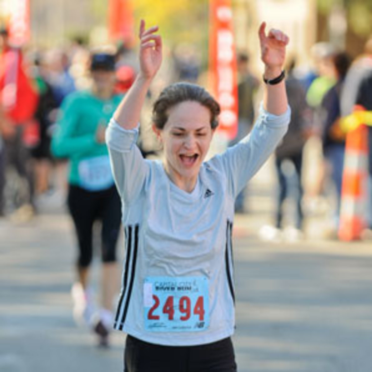 This is me crossing the finish line at MY FIRST RACE, a half-marathon--The Captial City River Run in  Lansing, MI on September 26, 2010. My official time was 2:08:51.