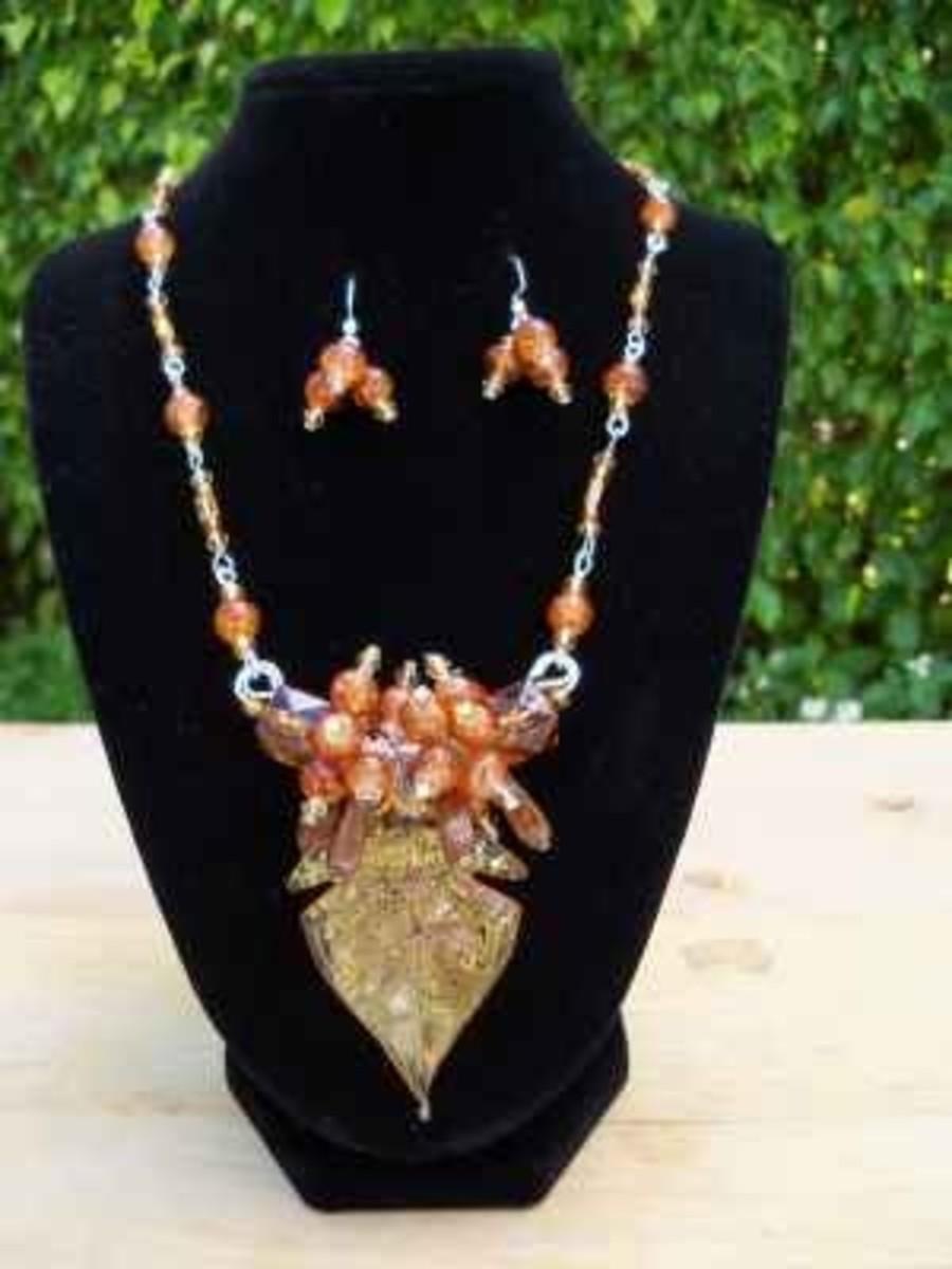 Handmade beaded jewelry - gold orange sunburst