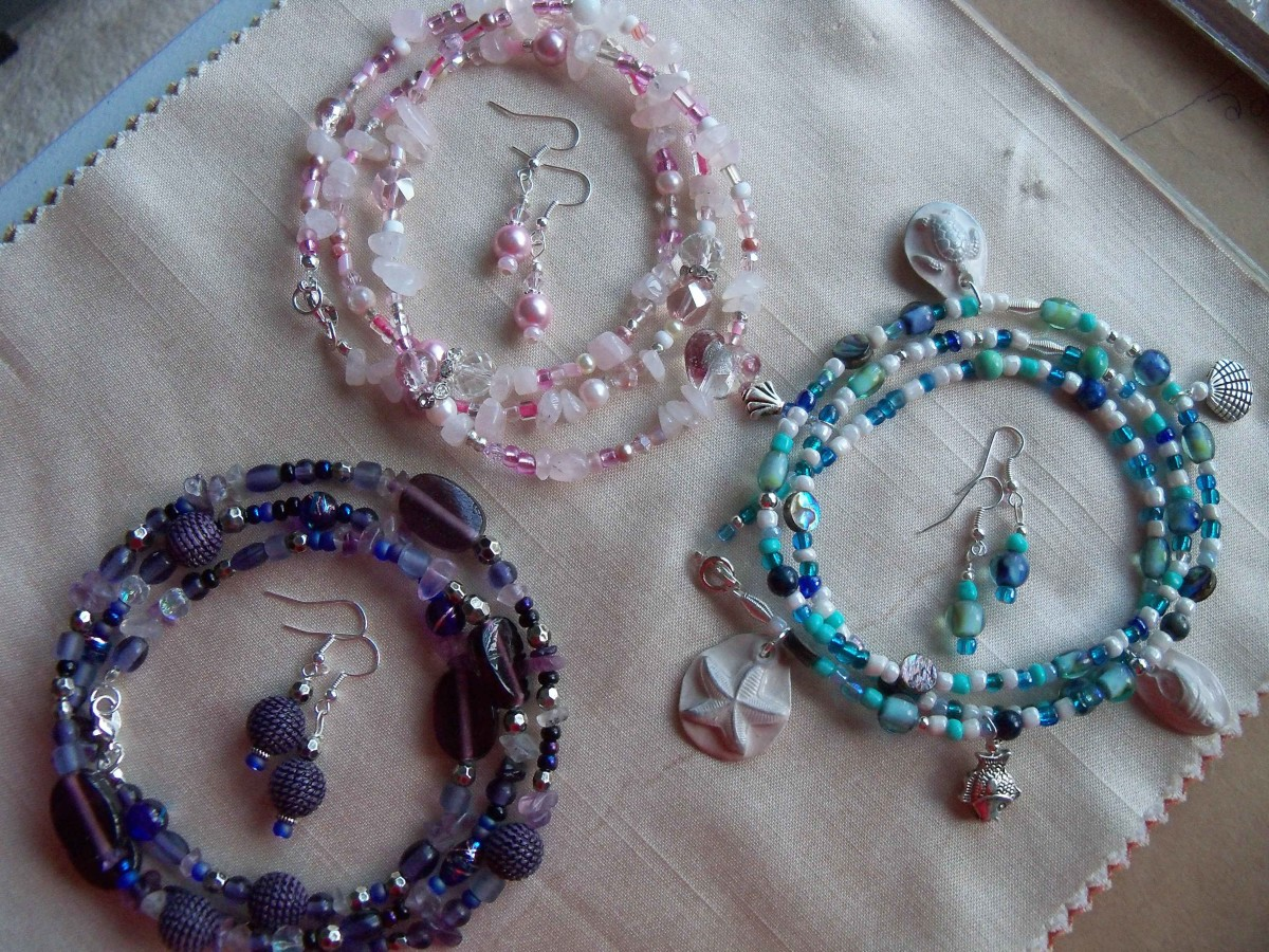 More boho anklets - one each in pink, purple, and sea colors