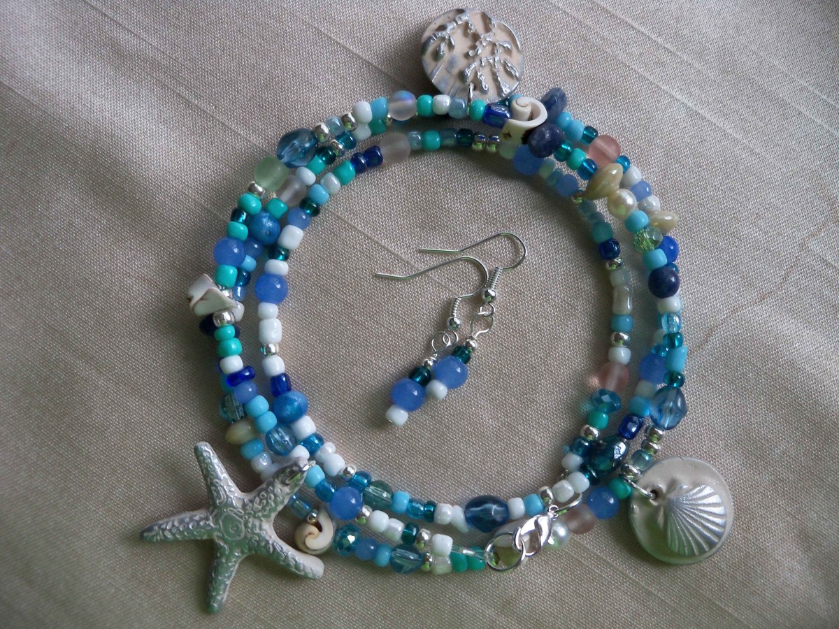 Boho anklet in ocean inspired colors - blues, teals, pearls, with polymer clay sea charms