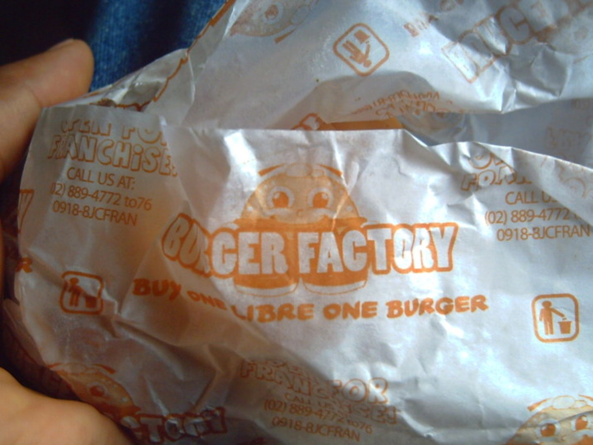 Buy One, Take One Burger - one of my snacks plus a bottle of mineral water (IAA)