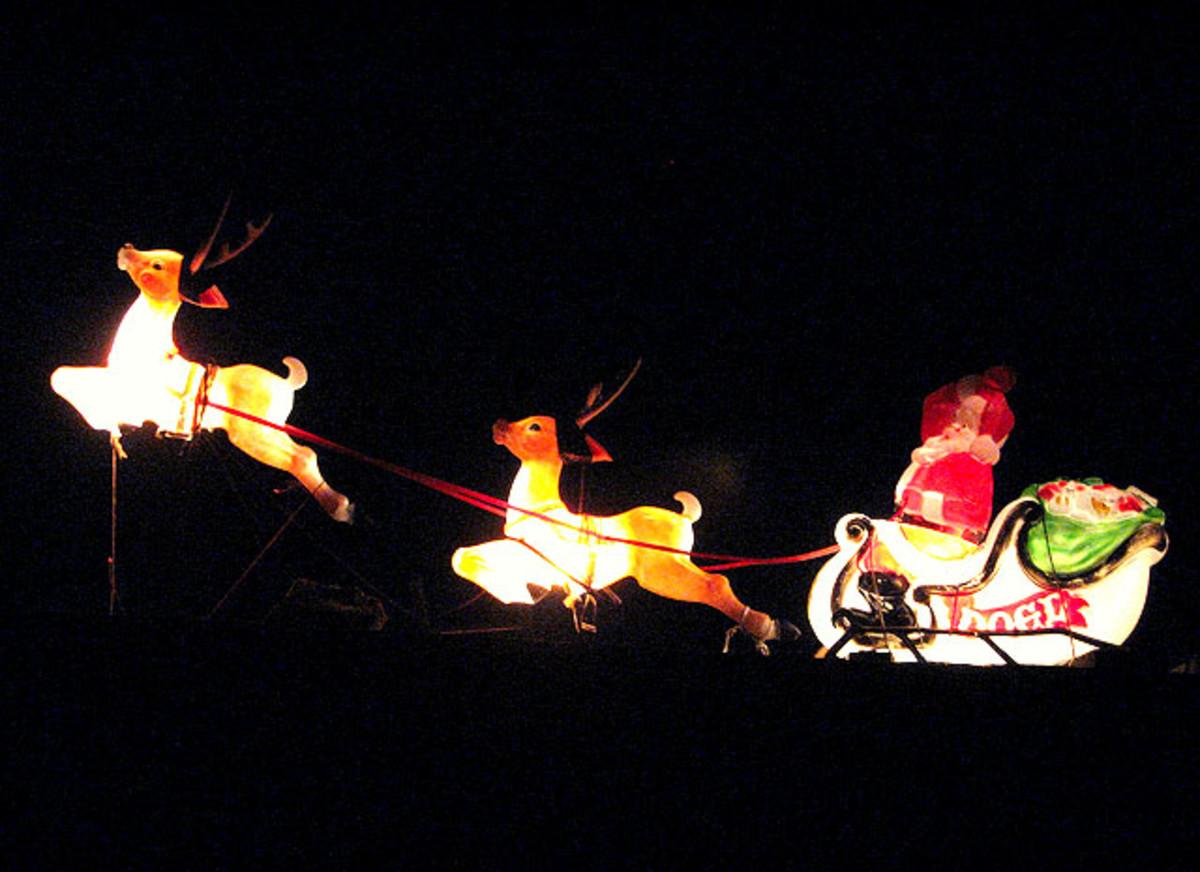Rudolph leading Santa's sleigh in the night sky