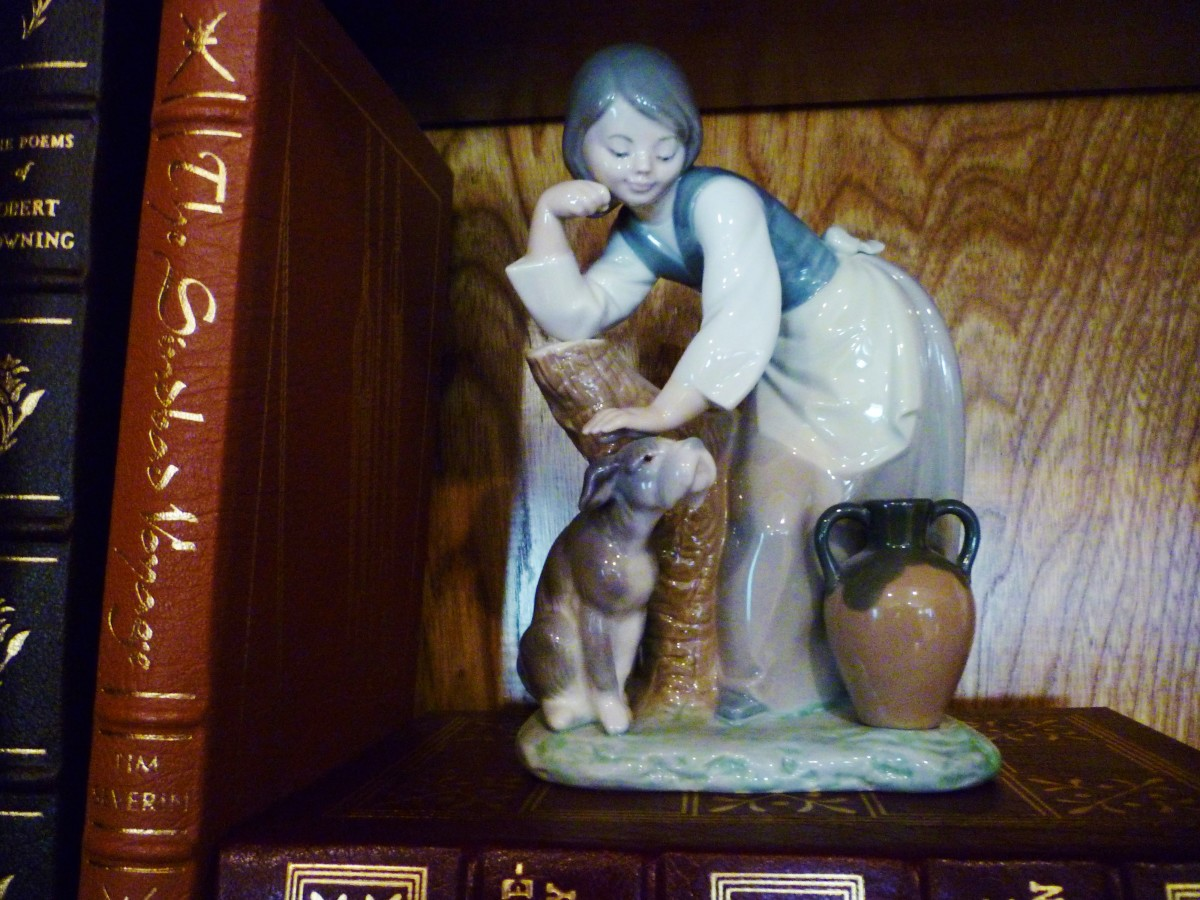 Lladro figurine brought home from Spain of girl petting a dog